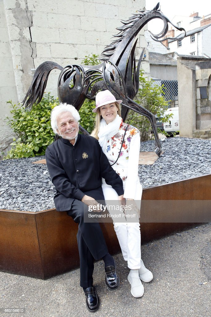 Artist and Designer Pascal Morabito and his wife attend Tribute To Jean-Claude Brialy during 'Journees Nationales du Livre et du Vin'on May 14, 2017 in Saumur, France.