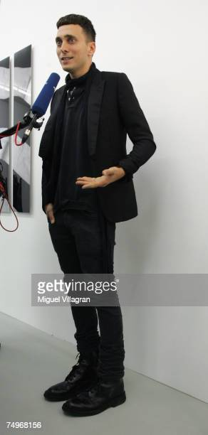 Artist and fashion designer Hedi Slimane talks to the media, during a group show curated by him at gallery Arndt & Partner on June 30, 2007 in...