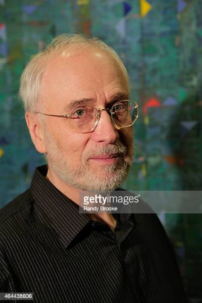 Artist and Film Producer Joe Fisher poses in front of one of his paintings during the FilmRise Celebrates new office in Industry City Brooklyn at...