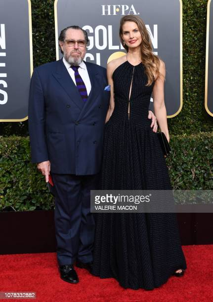 US artist and filmmaker Julian Schnabel and his partner Louise Kugelberg arrive for the 76th annual Golden Globe Awards on January 6 at the Beverly...