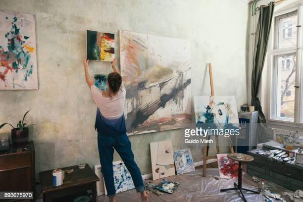 artist and oil paintings in studio. - hängen stock-fotos und bilder