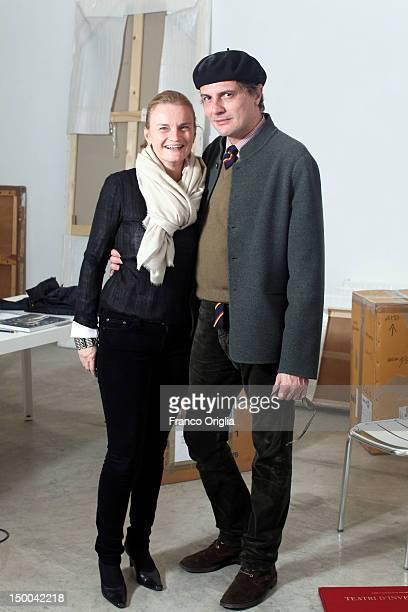 Artist and photographer Carlo Gavazzeni poses with his art dealer Valentina Moncada at the Galleria Moncada Via Margutta on December 13, 2011 in...