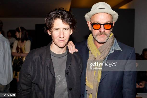 Artist and photographer Collier Schorr and musician Michael Stipe attends the Patrick Ervell Spring 2012 fashion show during Mercedes-Benz Fashion...