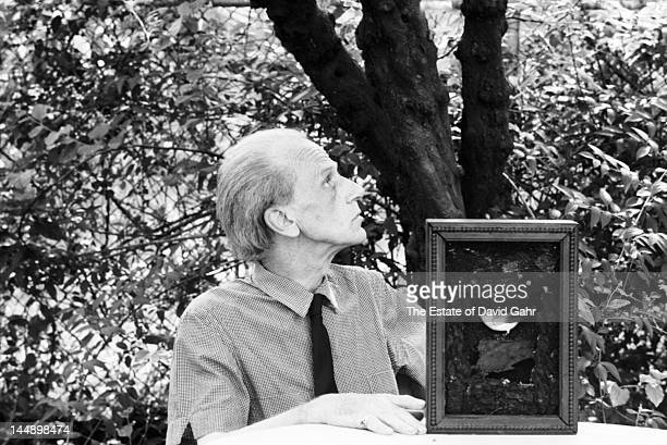Artist and sculptor Joseph Cornell poses for a portrait in 1967 at his home and studio in Flushing Queens New York