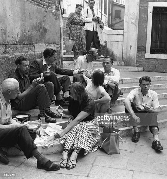 Artist and set designer John Piper composer Benjamin Britten and English tenor Peter Pears having a break whilst in Venice for the premiere of...