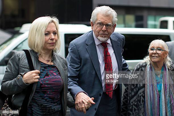 Artist and television personality Rolf Harris arrives at Southwark Crown Court with his wife Alwen Hughes and daughter Bindi Harris on May 8 2014 in...