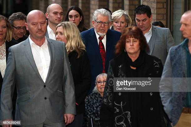 Artist and television personality Rolf Harris leaves Southwark Crown Court with family and friends on January 14 2014 in London England Mr Harris who...