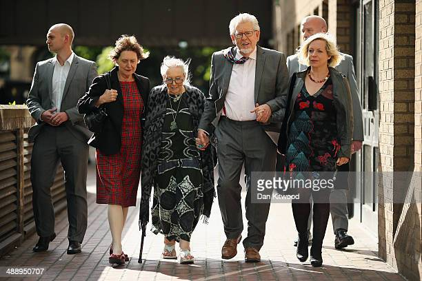 Artist and television personality Rolf Harris leaves Southwark Crown Court with his wife Alwen Hughes and daughter Bindi on May 9 2014 in London...
