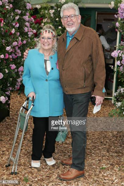 Artist and TV presenter Rolf Harris and Alwen Hughes visit the Chelsea Flower Show at Royal Hospital Chelsea on May 18 2009 in London England
