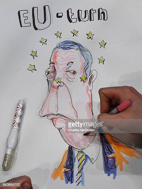 Artist and writer Brian John Spencer works on a political cartoon featuring Nigel Farage at the EU referendum count on June 23, 2016 in Belfast,...