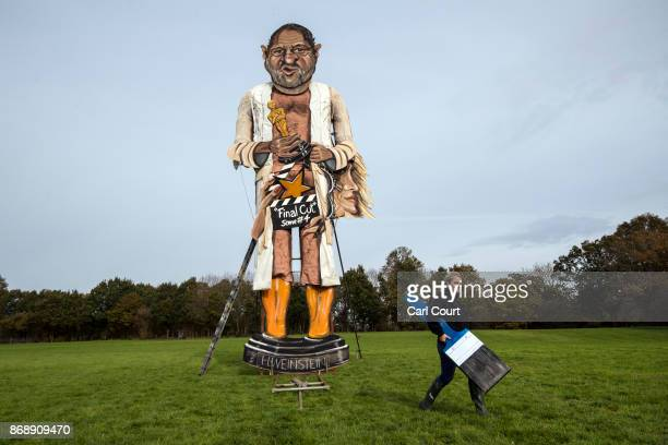 Artist Andrea Deans poses for a photograph with her work this year's Edenbridge Bonfire Society 'Celebrity Guy' effigy of film producer Harvey...