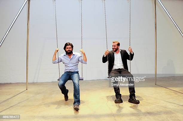 Artist Andrew Levitas and Eduardo Burillo attend Andrew Levitas Metalwork Playground opening reception at Blueshift Wynwood on April 10 2015 in Miami...