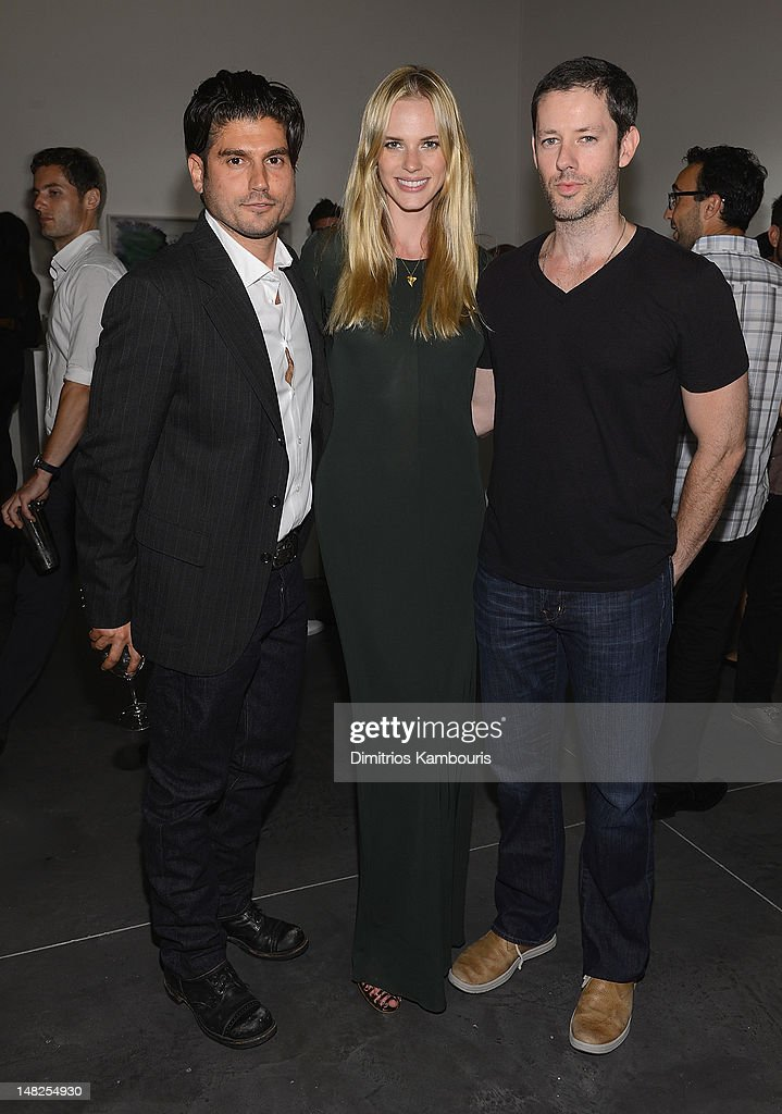 Artist Andrew Levitas, model Anne Vyalitsyna and Darren Le Gallo attend 'Metal Works Photography: Sculptures' By Andrew Levitas Exhibition at Phillips de Pury & Company on July 12, 2012 in New York City.