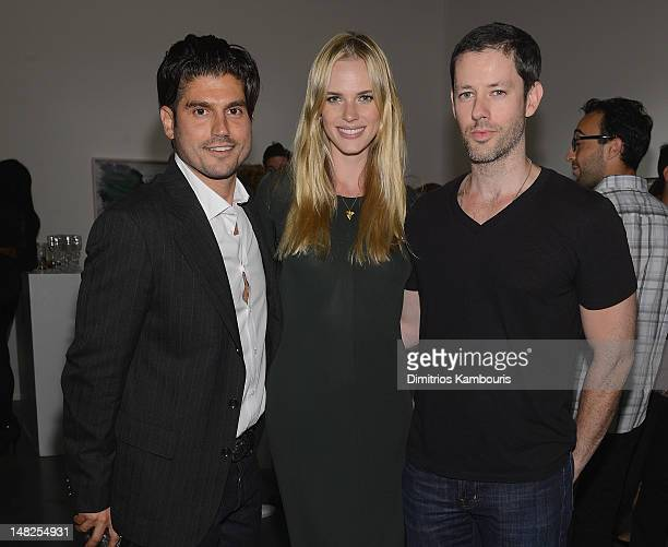Artist Andrew Levitas model Anne Vyalitsyna and Darren Le Gallo attend Metal Works Photography Sculptures By Andrew Levitas Exhibition at Phillips de...