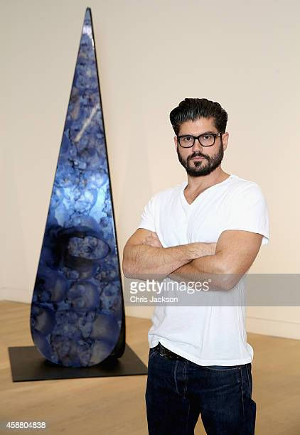 Artist Andrew Levitas poses with one of his sculptures in the exhibition Metalwork Photography A Survey/ Works by Andrew Levitas at Phillips Gallery...