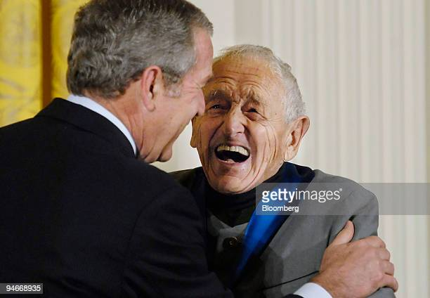 Artist Andrew Wyeth right shares a laugh with President George W Bush after receiving the National Medal of Arts at a ceremony in the East Room of...