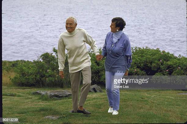 Artist Andrew Wyeth with his wife outside lighthouse that is their summer retreat