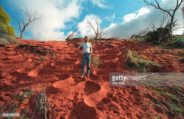 Artist Andy Goldsworthy who has created a sculpture entitled 'Red Earth' in the Australian outback 10 August 1991 Neg no 9132380 THE AGE Picture by...