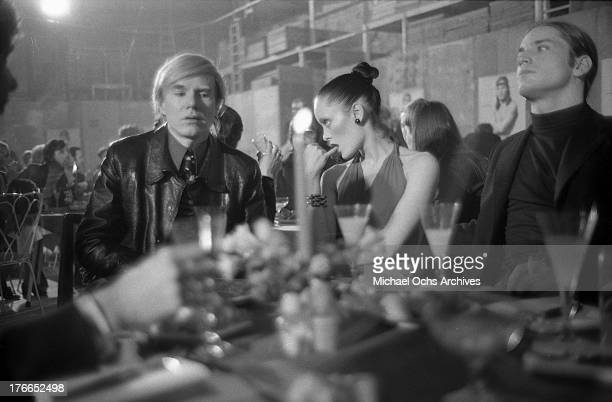 Artist Andy Warhol actress and model Jane Forth and actor Joe Dallesandro attend the party for the premiere of the movie 'Trash' on February 19 1971...