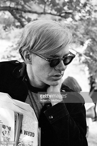 Artist Andy Warhol along with staff members and attendees of the New York Film Festival visits Stan Vanderbeek's movie drome in Stony Point New York...