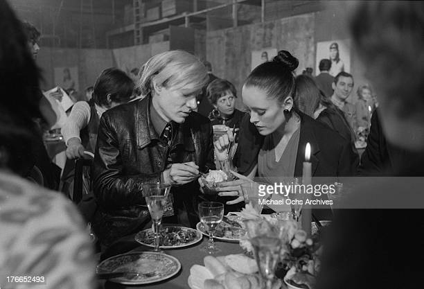 Artist Andy Warhol and actress and model Jane Forth attend the party for the premiere of the movie 'Trash' on February 19 1971 in Munich West Germany