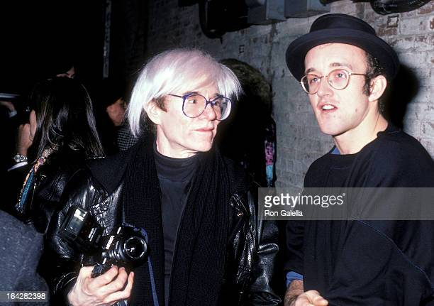 Artist Andy Warhol and artist Keith Haring attend The Tunnel Grand Opening Celebration on December 15 1986 at The Tunnel 220 12th Avenue in New York...