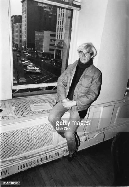 Artist Andy Warhol awaits a phone call on the windowsill of the Factory at 860 Broadway on March 4 New York City New York