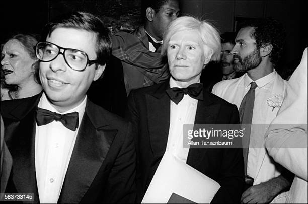 Artist Andy Warhol 'Interview' publisher Bob Colacello arrive at Times Square's Tango Palace for Mr Mike's Mondo Video Party New York New York...