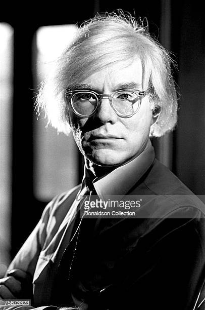 Artist Andy Warhol poses for a photo shoot at the Factory in New York.