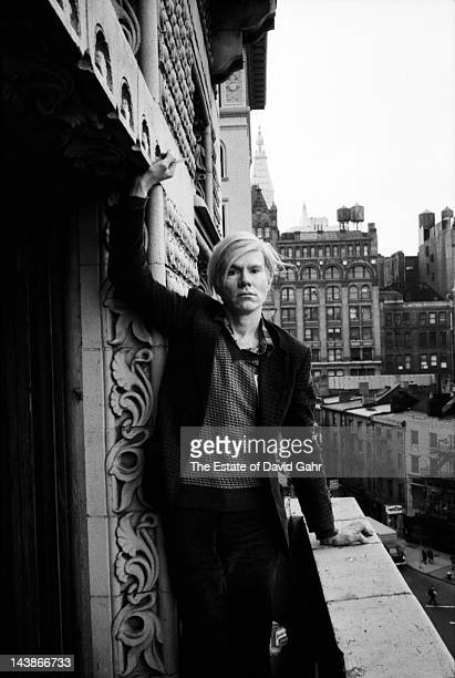 Artist Andy Warhol poses for a portrait on the balcony of his studio and business offices the 'new' Factory on May 5 1971 at 33 Union Square West in...