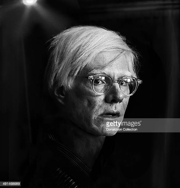 Artist Andy Warhol poses for a portrait session at the Factory in 1975 in New York New York