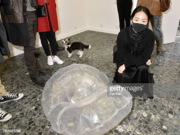 """Artist Ang Sookoon poses with her work during """"Ils Ont Dit Oui"""" Exhibition an Amalteo Institute Project Curated by Marc Molk at Galerie Marguerite..."""