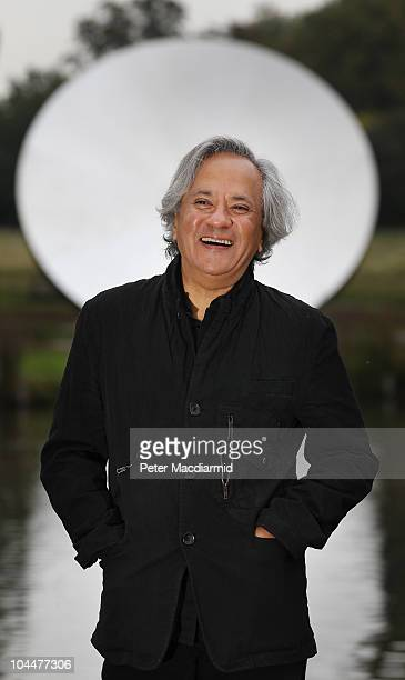 Artist Anish Kapoor stands in front of his sculpture Sky Mirror 2006 in Kensington Gardens on September 27 2010 in London England Four works are...