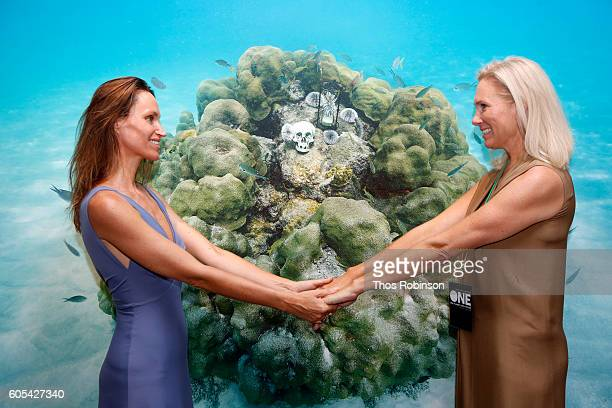 Artist Anne de Carbuccia greets guest at ONE One Planet One Future at Bank Street Theater on September 13 2016 in New York City