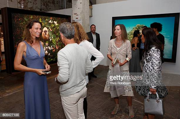Artist Anne de Carbuccia greets guests at ONE One Planet One Future at Bank Street Theater on September 13 2016 in New York City