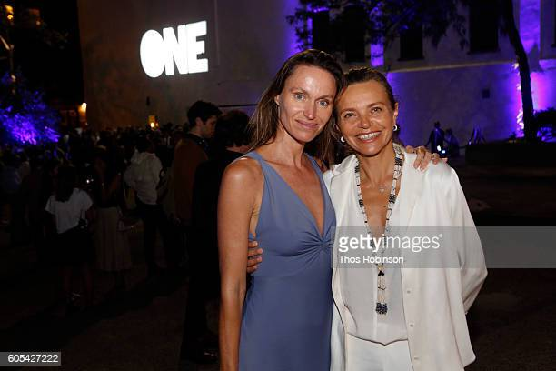 Artist Anne de Carbuccia poses with guest at ONE One Planet One Future at Bank Street Theater on September 13 2016 in New York City