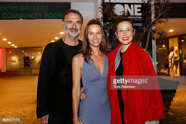 Artist Anne de Carbuccia poses with guests at ONE One Planet One Future at Bank Street Theater on September 13 2016 in New York City