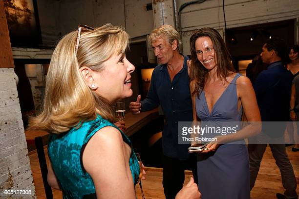 Artist Anne de Carbuccia speaks with guest at ONE One Planet One Future at Bank Street Theater on September 13 2016 in New York City