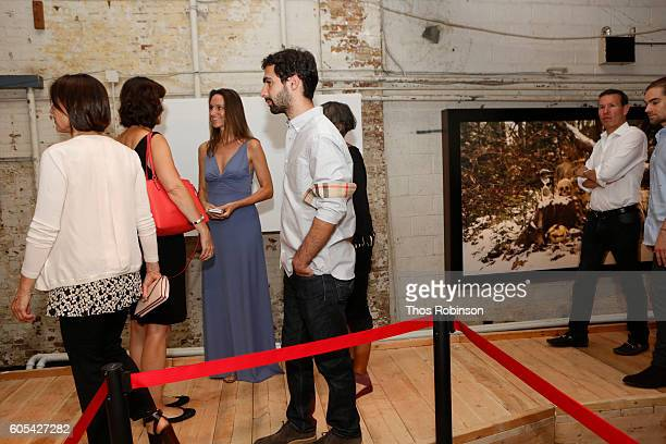 Artist Anne de Carbuccia speaks with guests at ONE One Planet One Future at Bank Street Theater on September 13 2016 in New York City