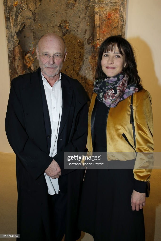 Artist, Anselm Kiefer and Actress, Sophie Marceau attends the 'Fur Andrea Emo' Anselm Kiefer's Exhibition at Thaddeus Ropac Gallery on February 10, 2018 in Paris, France.