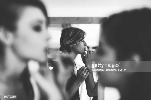 artist applying make-up on bride - marriage stock pictures, royalty-free photos & images