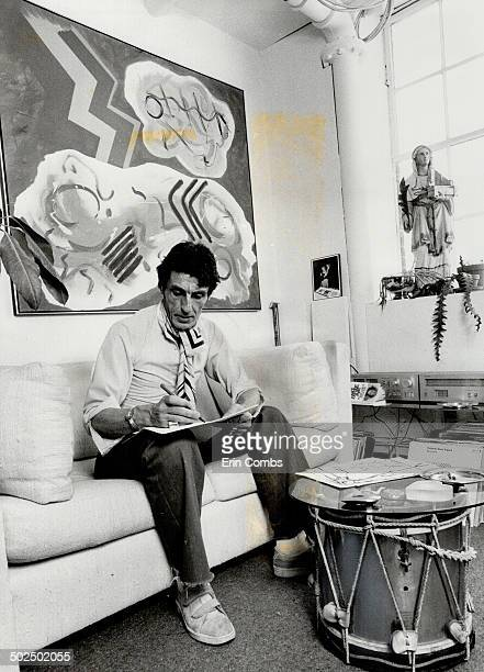 Artist at work Pollock sketches in studio area accented with Victorian collectibles Old drum serves as a coffee table
