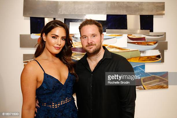 Artist Beau Dunn and James Fay attend Pareidolia art exhibition at De Re Gallery on October 22 2016 in West Hollywood California