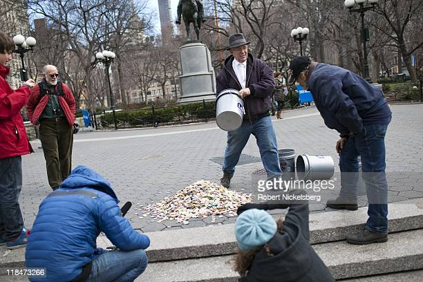 Artist Beriah Wall displays his ceramic tokens during the filming of a segment on Wall's artwork March 13 2011 by documentary filmmaker Albert...