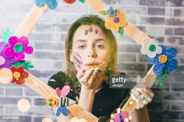 Artist blowing tinsels