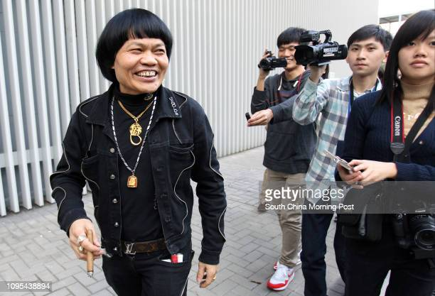 Artist Bobby Yip Gengsang also known as Bat Leung Gam passed by the famous 'Lennon Wall' at Tamar 06JAN15
