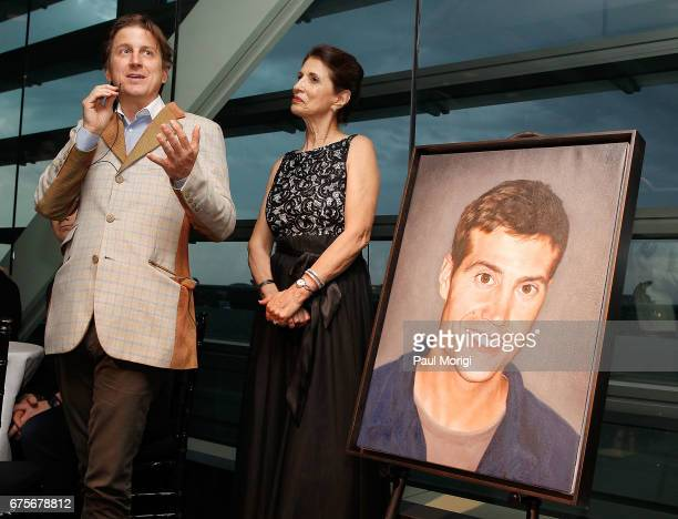 Artist Bradley McCallum unveils a portrait of journalist James Foley at the 2017 James W Foley Freedom Awards at the Newseum on May 1 2017 in...