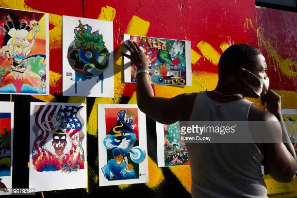 Artist Brian Culpepper sells his paintings in an area dubbed the Capitol Hill Autonomous Zone on June 12 2020 in Seattle Washington The area had been...