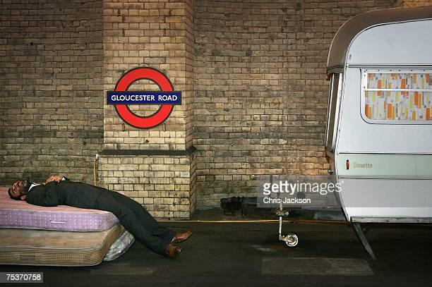 Artist Brian Griffiths poses next to his new installation entitled 'Life Is A Laugh' at Gloucester Road tube station on July 12 2007 in London...