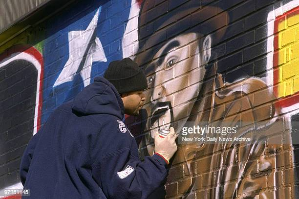 Artist calling himself BG 183 puts the finishing touches on a memorial mural for the rapper Big Pun at E 163rd St and Westchester AveThe 28yearold...